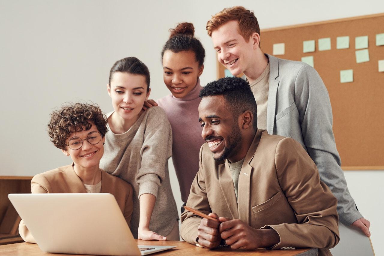 people looking on laptop